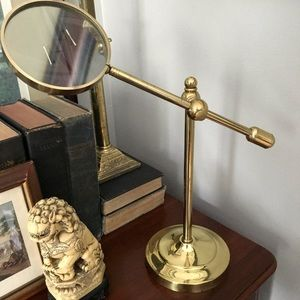 Vintage magnifying glass on brass stand